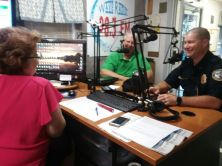 """Susan and George talking""""hurricanes"""" with Batallion Chief Paul Flateu"""